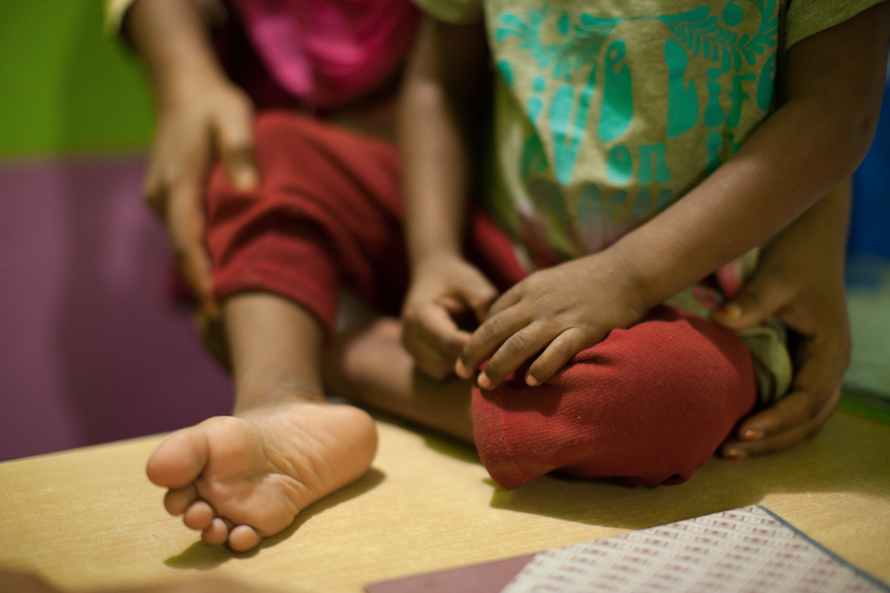 Child protection policy - a little boy's hands and feet.