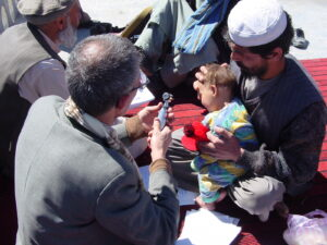 Born in Refuge: Helping the Helpless - Doctors in the Middle East administering care to a baby.