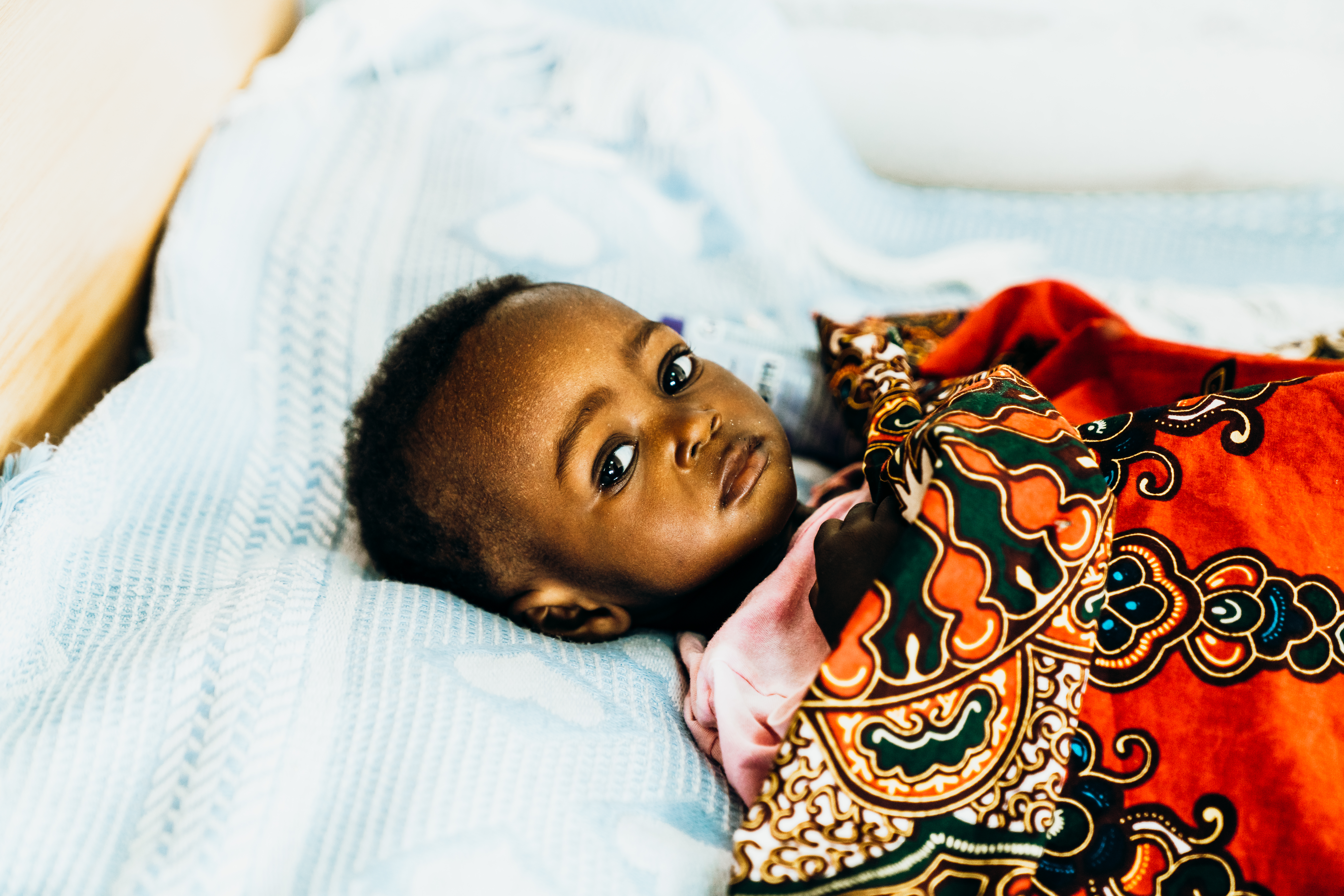 Angola baby in red blanket